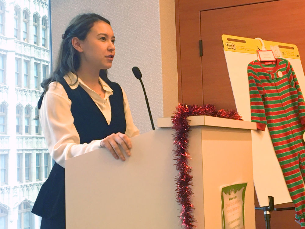 Comcast intern speaks at the co-op holiday celebration